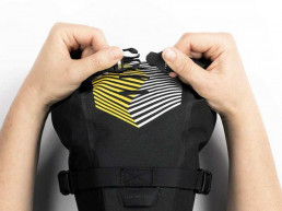 Apidura Saddle Pack roll up closing