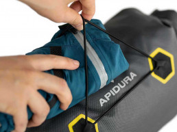 Apidura Expedition handlebar pack feature bungee